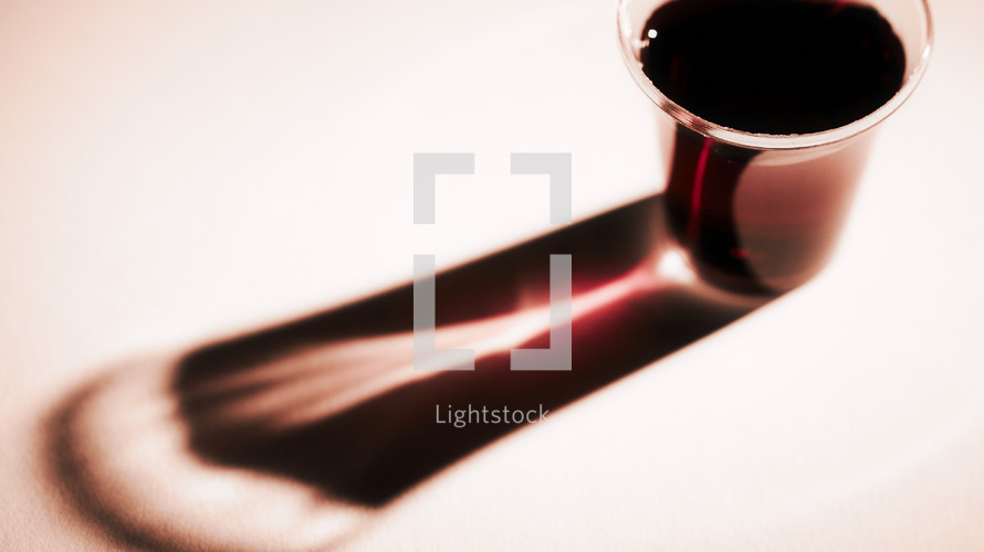 A communion cup and its reflection isolated on white