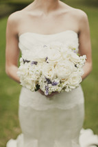A bride holds her bouquet of flowers