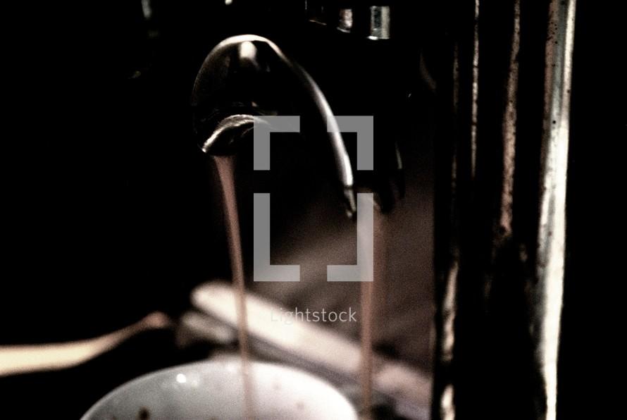 cappuccino maker pouring