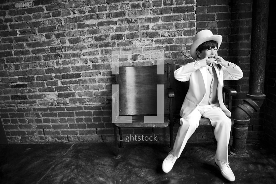 Boy in tuxedo and top hat
