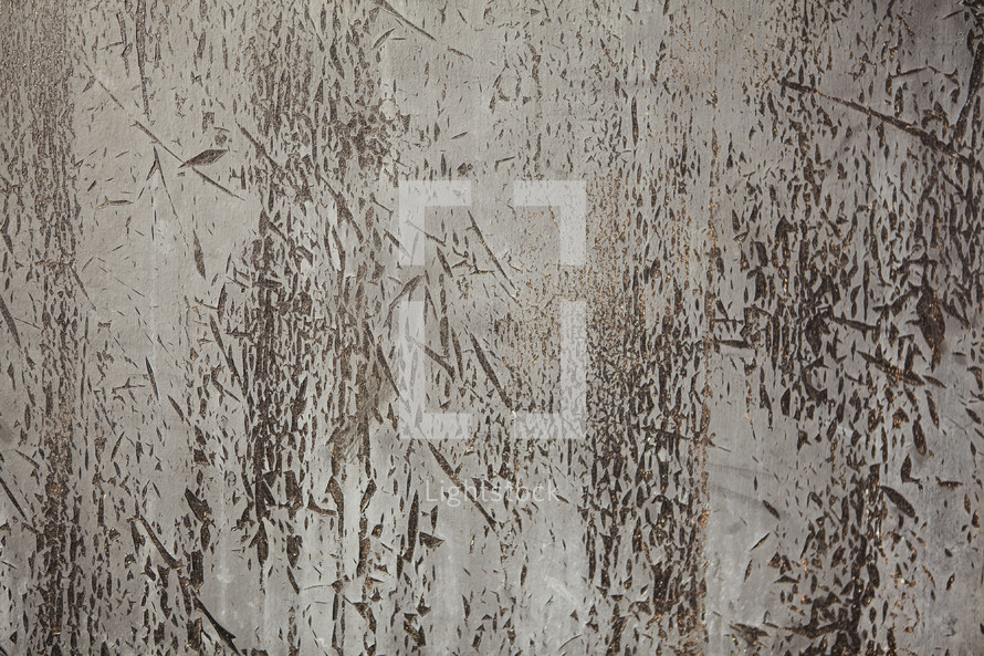 pealing paint on a concrete wall