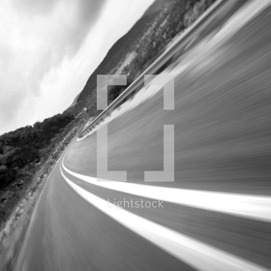 Asphalt blurred highway with double dividing line - traveling at fast speeds