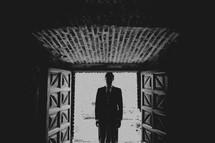 Man standing in a doorway