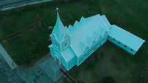 aerial view over a mint green church