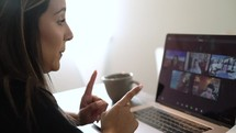 a woman working from home on a video conference