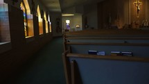 rows of pews in an empty church