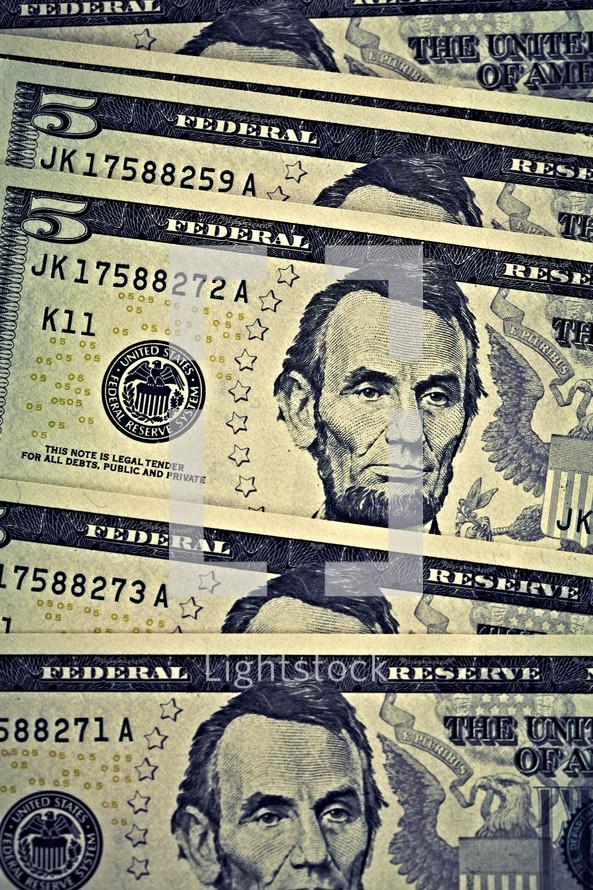 A group of five dollar bills
