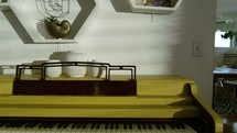 home interior with piano and dining room table