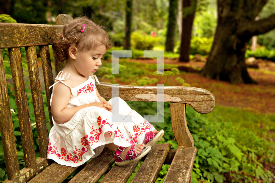Girl sitting on park bench