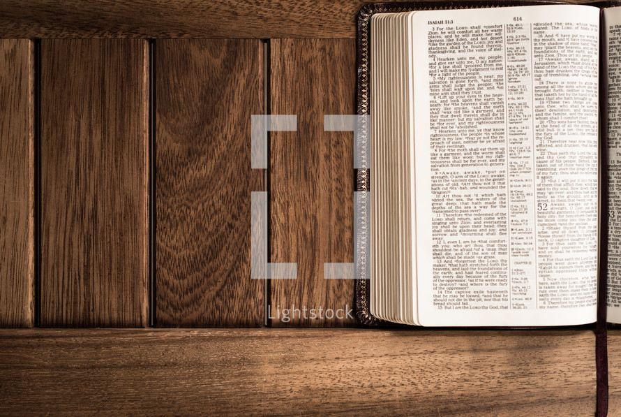 A Bible against wood texture.