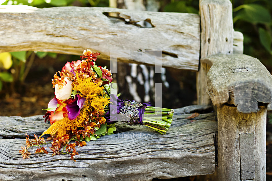 Bouquet of flowers on wood bench