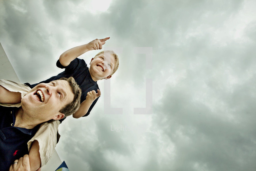 Boy sitting on man's shoulders