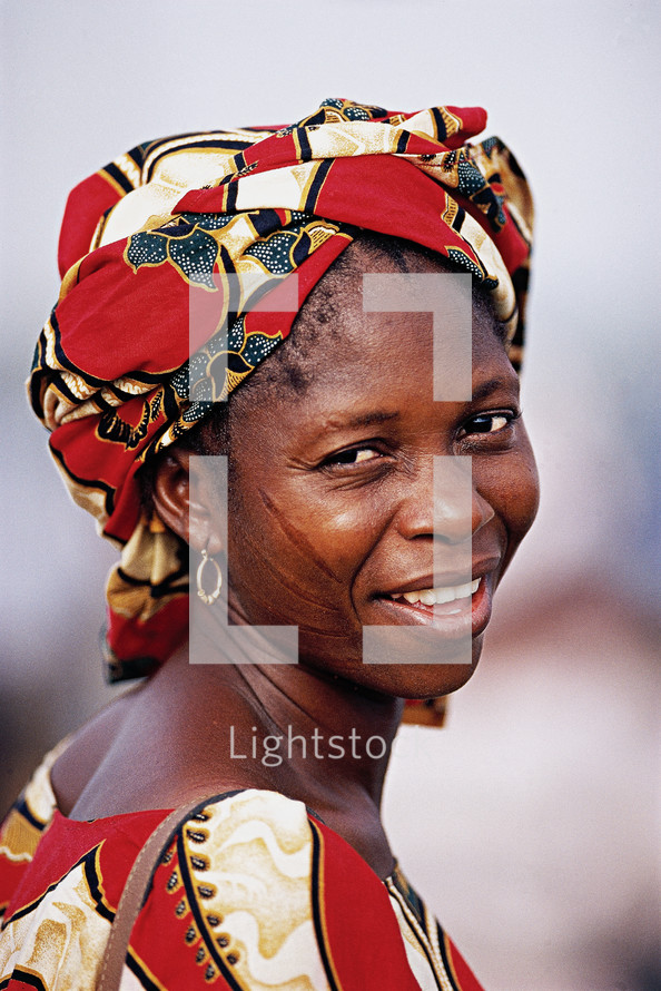 African woman in a cloth hat {Also try search for 'Ethnic Faces'}