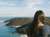a woman standing at the top of a cliff overlooking Nelson Bay