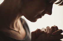 profile of a woman praying