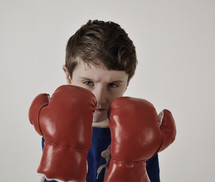 a boy with boxing gloves