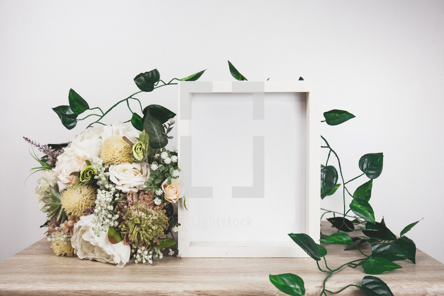 flowers and vines around a frame
