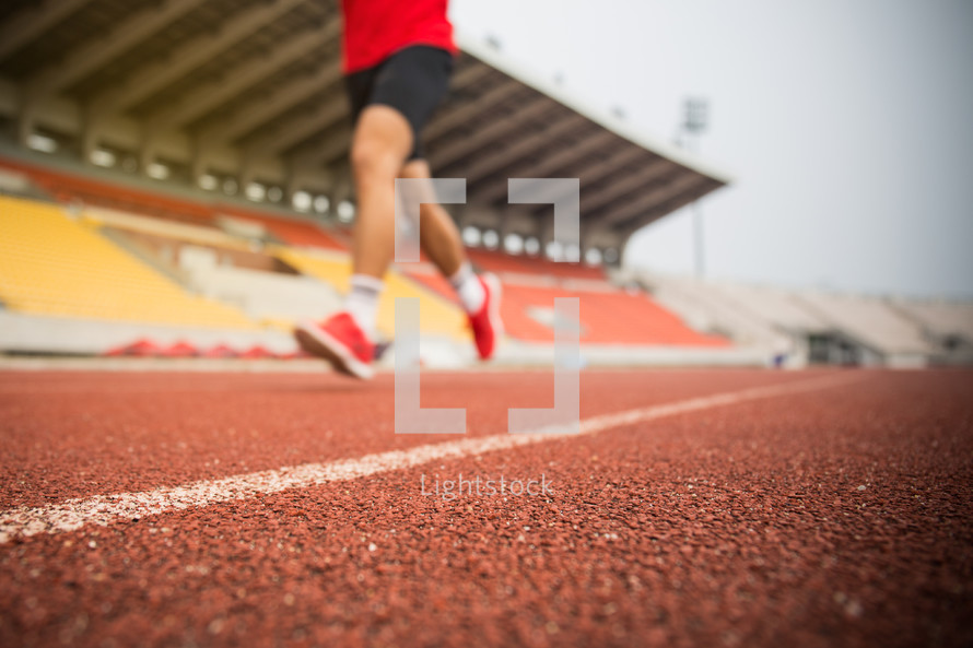 boy running on a track