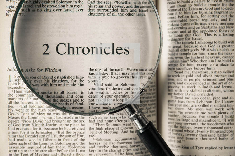 magnifying glass over Bible - 2 Chronicles