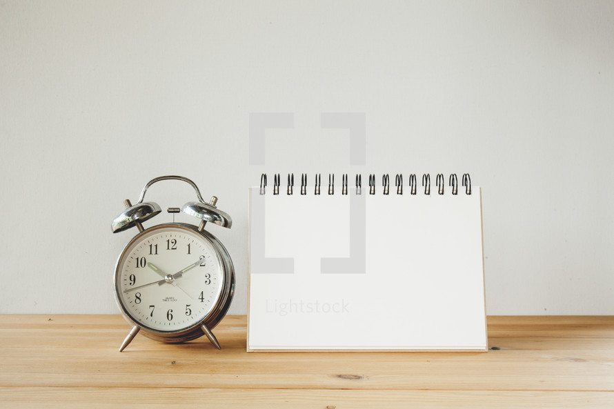 alarm clock and notepad