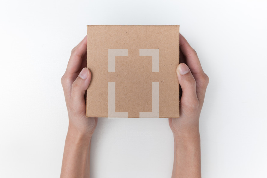 arms holding out a gift box