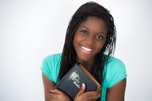 A teen girl holding a Bible.