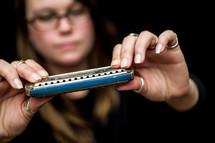 woman holding a harmonica