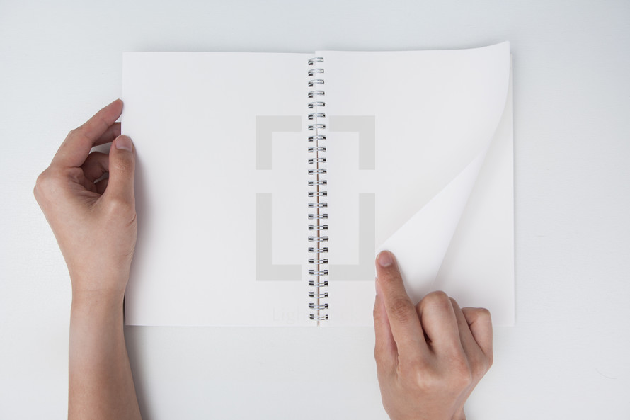 turning pages in a blank journal