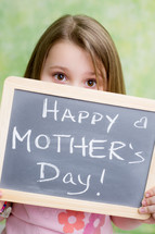 girl child holding a Happy Mother's day sign