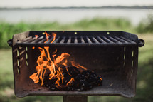 Burning charcoal in an outside grill.
