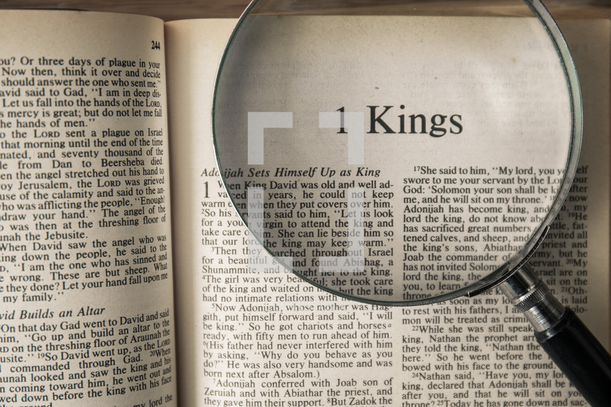 magnifying glass over Bible - 1 Kings