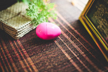 a plastic Easter egg on a table cloth