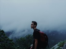 man with a backpack on a foggy mountain