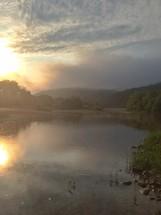 Misty sunrise on the lake.