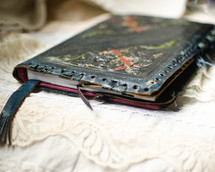 Worn, leather notebook. Prayer journal or Bible notes.