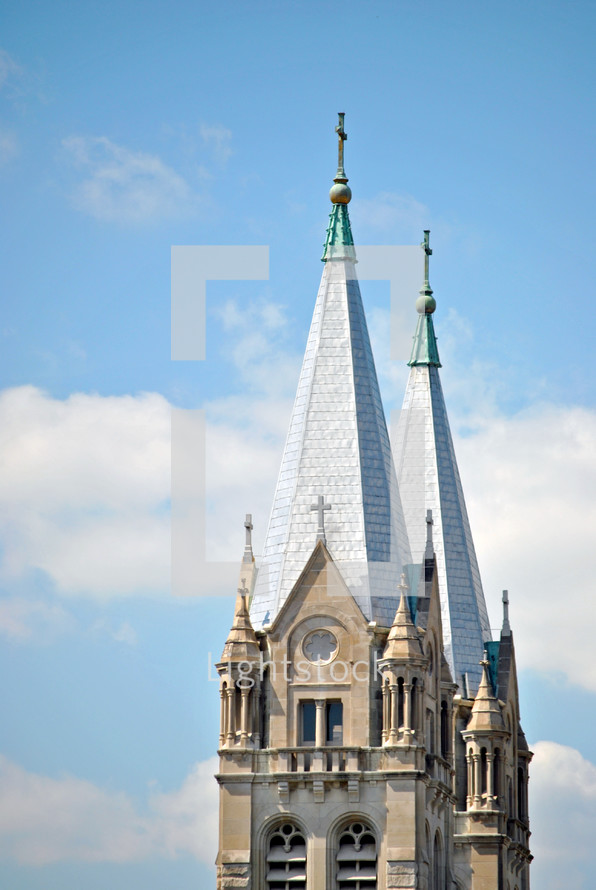 Richardsonian Romanesque architecture style in twin church steeples; Catholic church of St. Joseph, Joliet, IL