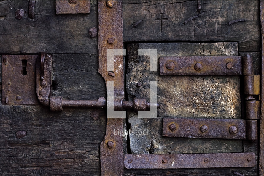 rusty latches on an old door