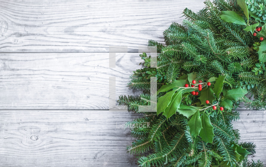 Christmas Wreath on a white wood background