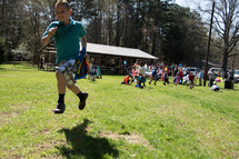 children running during an Easter egg hunt