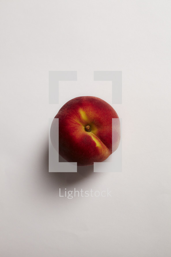 The top of a peach isolated on white