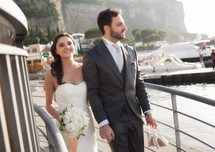 bride and groom at a harbor