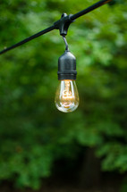 hanging lightbulbs outdoors