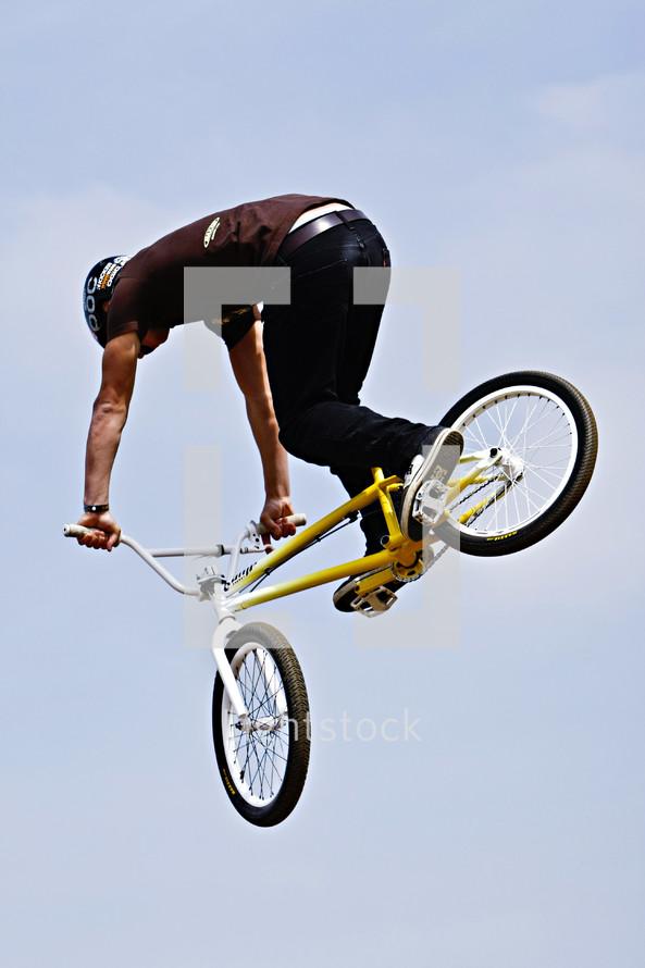 man doing stunts on a trick bike BMX x games