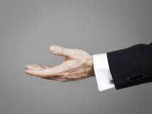 outstretched hand of a businessman