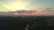 Daybreak over the treetops.