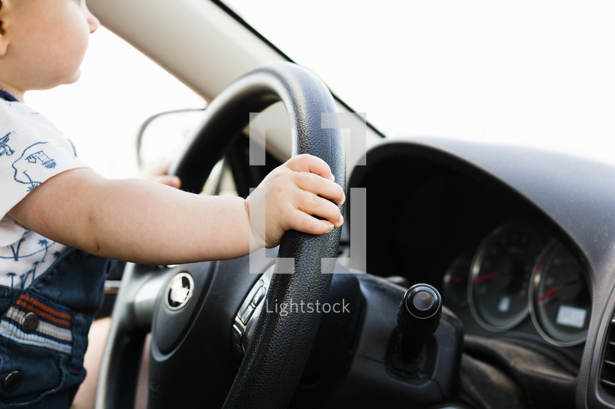 toddler at the steering wheel