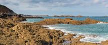 tide washing onto rocks along a shore