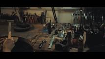 woman sanding in a workshop