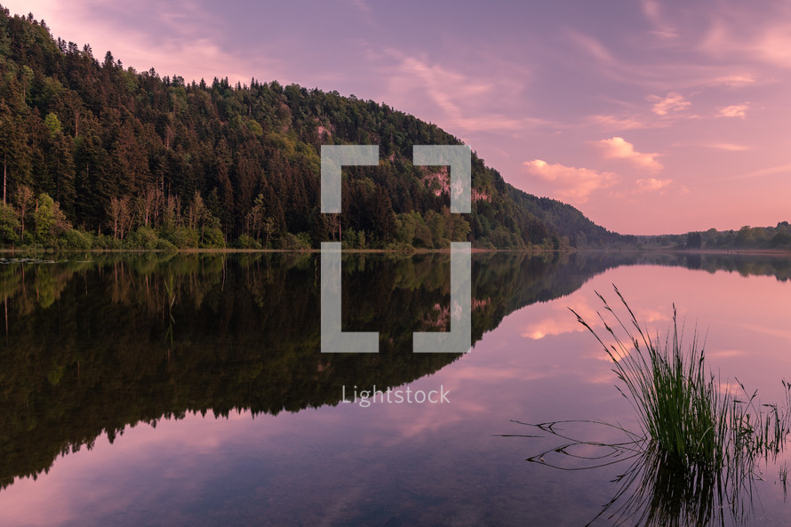 still lake at sunrise