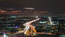 Timelapse video of Los Angeles freeway and traffic at sunset.  Shot from a city building rooftop in downtown.